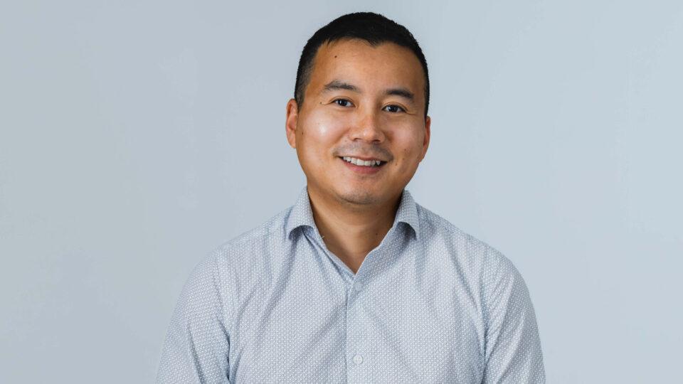 A headshot of Chris, a staff member