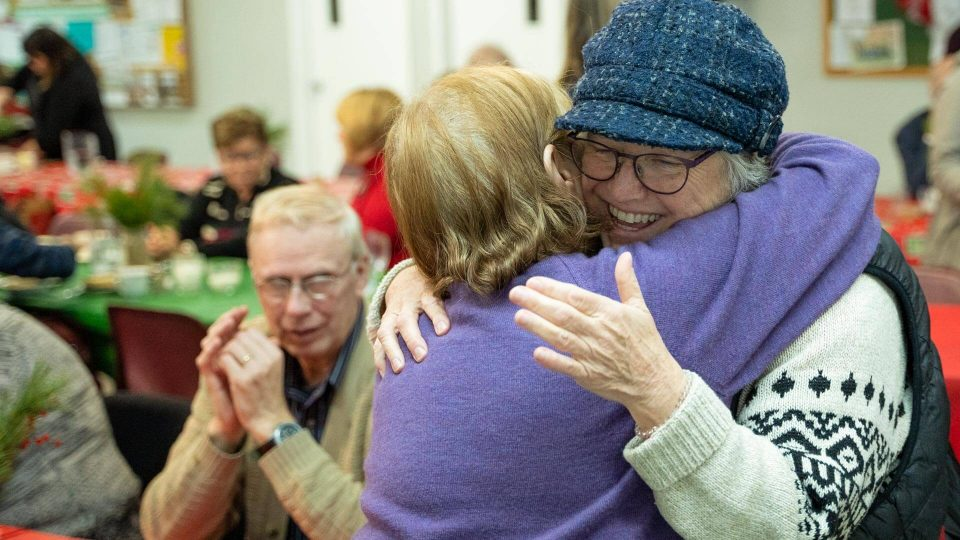 Two people hug at a United Way event.