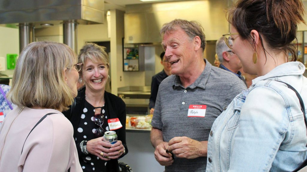 United Way staff and volunteers laughing in the kitchen of a United Way event.
