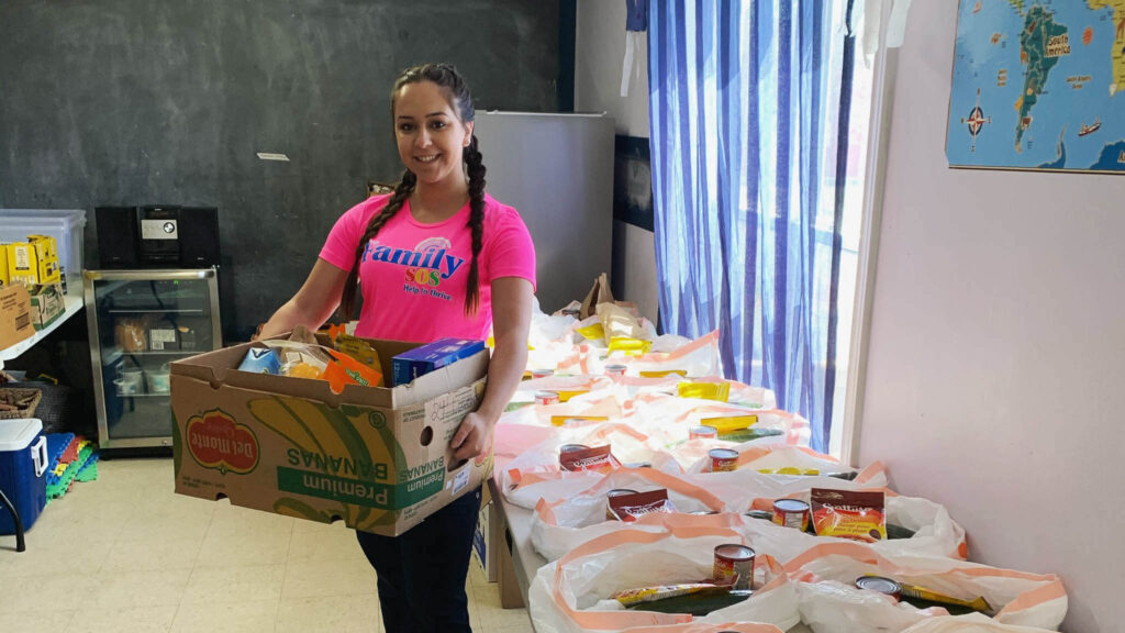 Family SOS volunteer with supplies