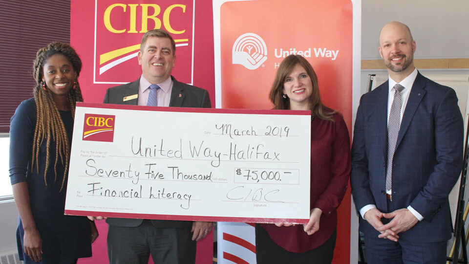 United Way & CIBC representatives holding a large cheque
