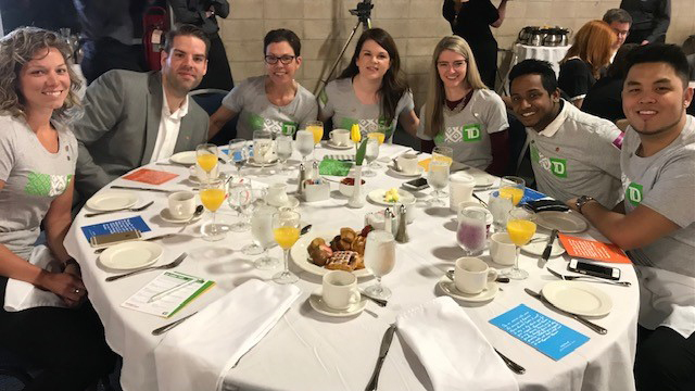 TD volunteers sitting around a table at a United Way Halifax event