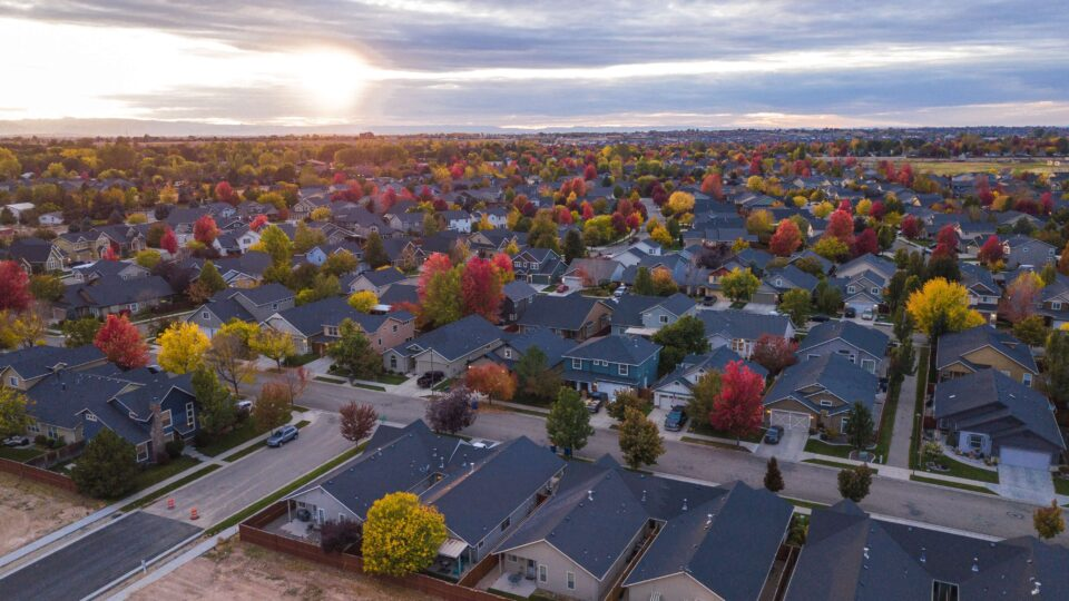 Sun setting over a suburban community in the fall.
