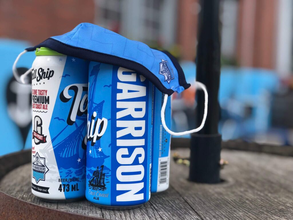 Blue Garrison cans with blue Wanderers mask sitting on top