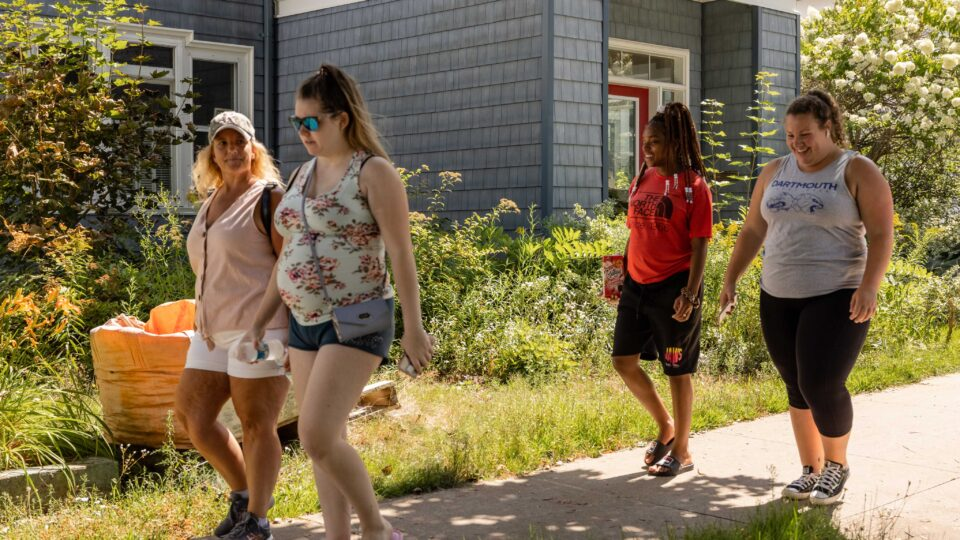 four people from the Elizabeth Fry Society's walking group walking along a sidewalk